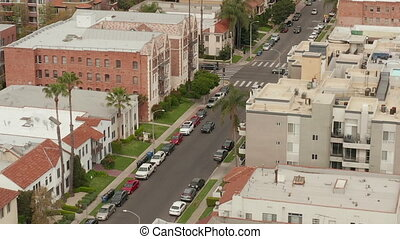 AERIAL: Typical Houses , Apartments , Residential Area in West Hollywood, California with Beautiful Rich colors in Trees and Buildings HD