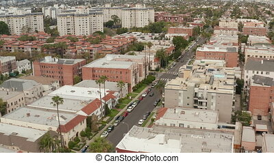 AERIAL: Typical Houses , Apartments , Residential Area in West Hollywood, California with Beautiful Rich colors in Trees and Buildings 4K
