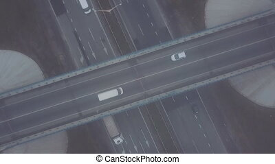 Aerial vertical shot with rotation. Cars driving by the...