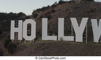 AERIAL: Very close to Hollywood Sign at Sunset, Los Angeles, California HD