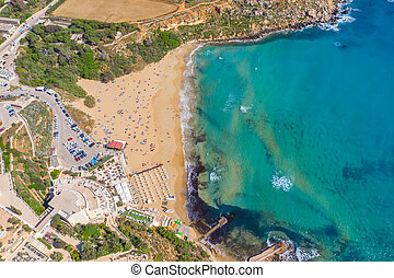 Aerial vew from fying drone view of the wild beach with sunbathers resting people.