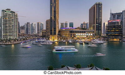 Aerial vew of Dubai Marina with shoping mall, restaurants,...