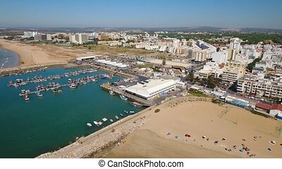 Aerial. Video, fishing port and moored ships Quarteira town....