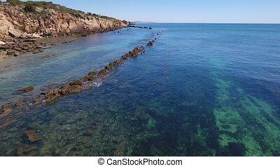 Aerial. Video footage on the bay Arrifes, underwater hunter on water. Albufeira Algarve