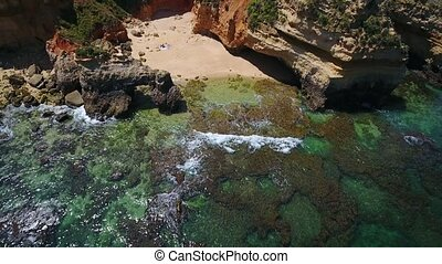Aerial. Video from the air beach Camilo, tourists sunbathe,...