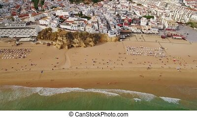 Aerial. Video from the sky, beach fishermen in the city of Albufeira.