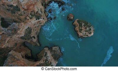 Aerial. Video from the sky of the Portuguese cliffs of the beach of Marinha, Portimao. Algarve.