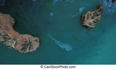 Aerial. Video from the sky of the Portuguese cliffs of the beach of Marinha, Portimao. Algarve.