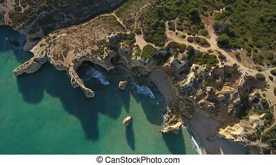 Aerial. Video from the sky of the rocks and the shores of the beaches of Portimao. Algarve