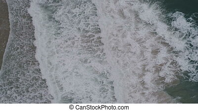Aerial video of beautiful sea waves crashing on shore