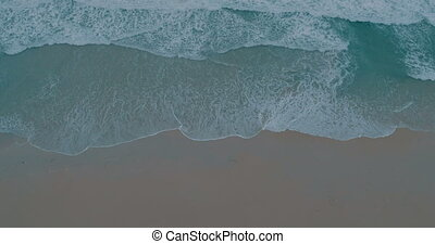 Aerial video of beautiful sea waves crashing on shore -...