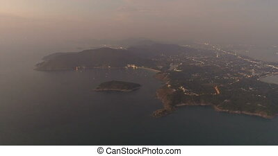 Aerial video of Phuket island with boats on the sea near Promthep Cape during sunset