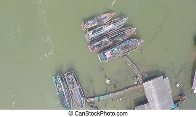 Aerial video of Thai fishermen village and old fishing...