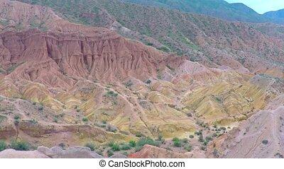 Aerial video of uranium deposits in red rocks. Kyrgyzstan -...