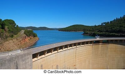 Aerial video shooting. Reservoir, dam bravura, drinking water supplies from a bird's eye view. Portugal, Algarve, Monchique. Europe