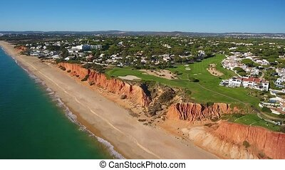 Aerial. Video shot of a drone over the beaches Vale de Lobo, Algarve.