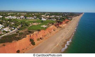 Aerial. Video shot of a drone over the beaches Vale de Lobo, Algarve.