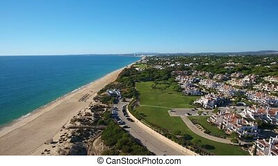 Aerial. Video shot of a drone over the beaches Vale de Lobo,...