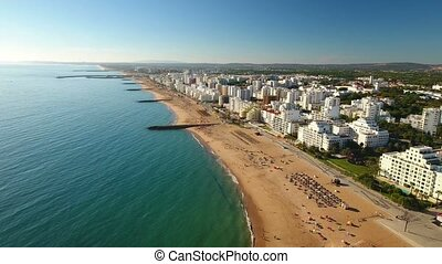 Aerial. Video tourist town beaches, Quarteira. - Aerial....