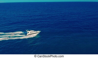 Aerial view. A Powerboat Travelling Through the Water at...