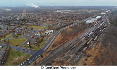 Aerial view a town an a municipality in over railway tracks. Sunny summer day. NJ USA