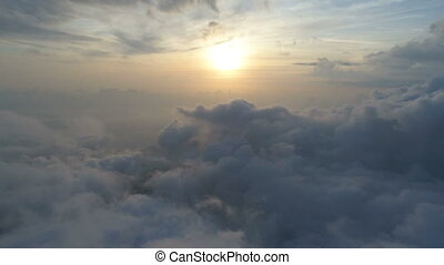 aerial view above the clouds, sunset