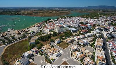 Aerial view, above the town of Alvor, the harbor. - Aerial...