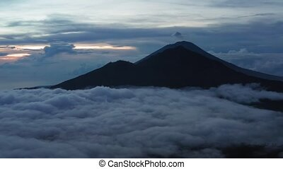 Active Indonesian volcano Batur in the tropical island Bali. Indonesia. Batur volcano sunrise serenity. Dawn sky at morning in mountain. Serenity of mountain landscape, travel concept.