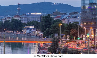 Aerial view along the Danube Canal in Vienna day to night ...