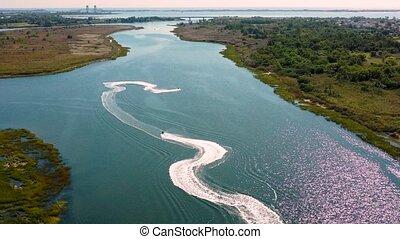 Aerial view. aquabikers 4k - Aerial view. waves water...