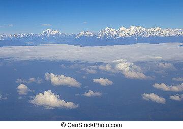 Aerial view at Himalayas - View through aircraft window at...