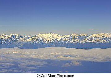 Aerial view at Himalayas - View through aircraft window at...