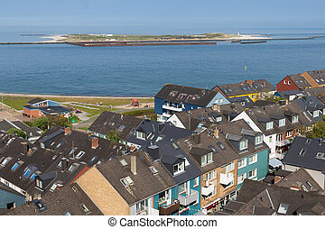 Aerial view at houses of German island Helgoland and a view at Dune