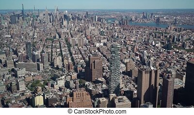 Aerial view at New York city. Downtown, Hudson Bay, the Brooklyn bridge and the towers of Lower Manhattan.