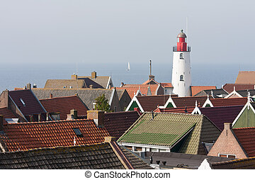 Aerial view at the lighthouse and roofs of a old characteristic fishing village in the Netherlands