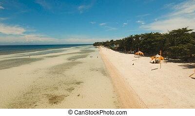 Aerial view beautiful beach on a tropical island....