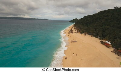 Aerial view beautiful beach on tropical island in stormy weather. Boracay island Philippines.