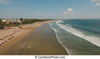 Aerial view beautiful beach with surfers, Bali, Kuta. -...