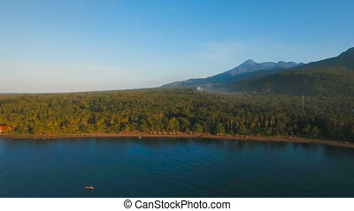 Aerial view beautiful coastline on the tropical island with volcanic sand beach. Camiguin island Philippines.