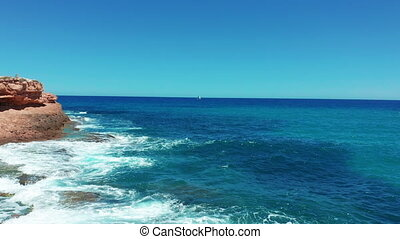 Aerial view. Beautiful sailboat on background blue ocean on a bright sunny day.