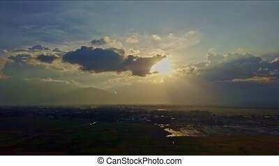 Aerial View Blue Sky with Sun Disk behind Light Clouds -...