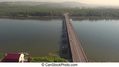 Aerial view. Bridge with traffic over the river w on a sunny...