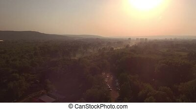 Aerial view. bright sun and smog over the city. Problems of...