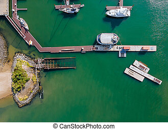 Aerial view by small group of sail boats in a marina