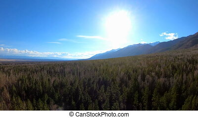 Aerial View. Camera moves rising up from forest. Mountain landscape. Siberia