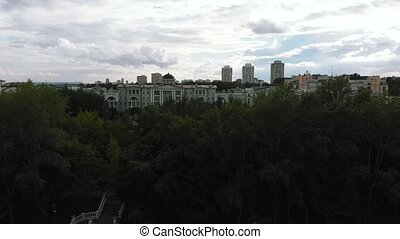 Aerial view, camera on drone flying around the buildings of ...