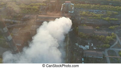 Aerial view. Chimney pollution pipes with grey smoke. ...