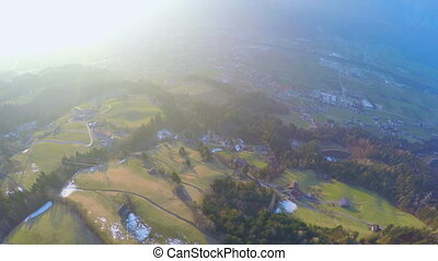 """""""Aerial view, city in green valley at mountain bottom,..."""