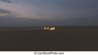 Aerial view. Combine Night Harvester Gathers the Wheat crop