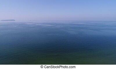 aerial view, descent in of calm, blue sea